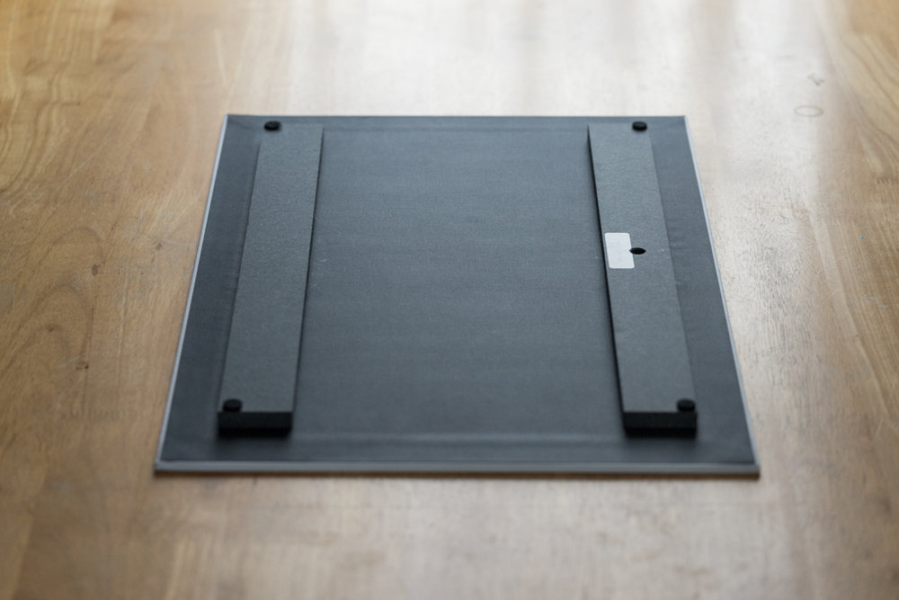 Thinwrap, 12X18, back view, inset wall mounting block.  A 1/2″ spacer is applied to the back of the thinwrap, which makes the print appear to float from the wall. A mounting block is affixed on the back of the thinwrap, and a single nail can be used for wall placement.