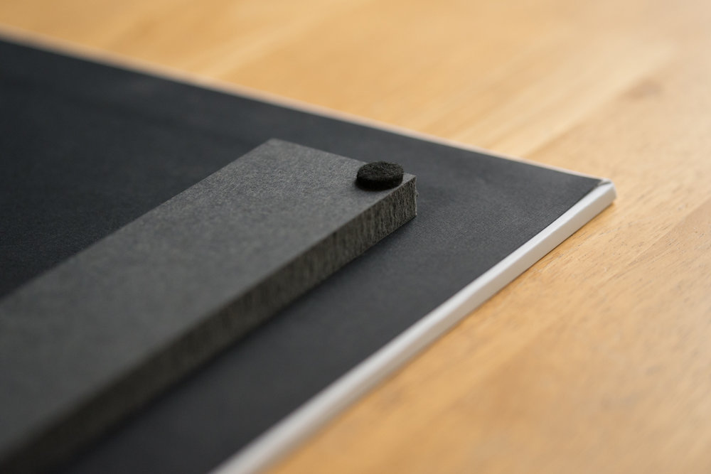 Thinwrap, 12X18, back view,inset wall mounting block with bumper.  A 1/2″ spacer is applied to the back of the thinwrap, which makes the print appear to float from the wall. A mounting block is affixed on the back of the thinwrap, and a single nail can be used for wall placement.