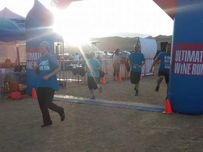 Marisa crossing the finish line.