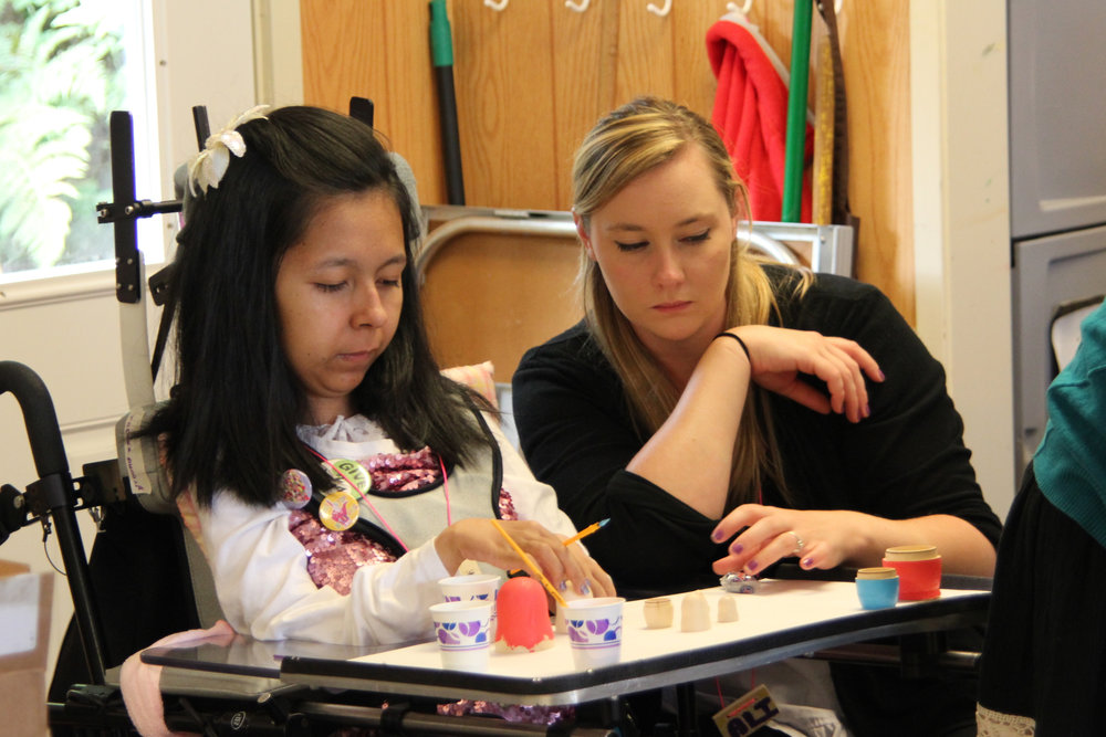 Ali and her camper at Arts & Crafts. Camp Promise-West 2013