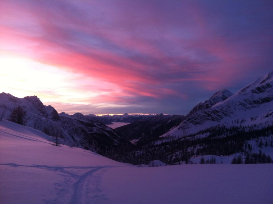 Sunset ski from lodge in Purcell range above Kootenay Lake, Canada