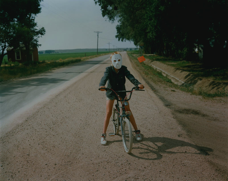 Fig 4. Michael Ormerod, Child in Mask on Bike, from States of America, 1986. C-Type print.