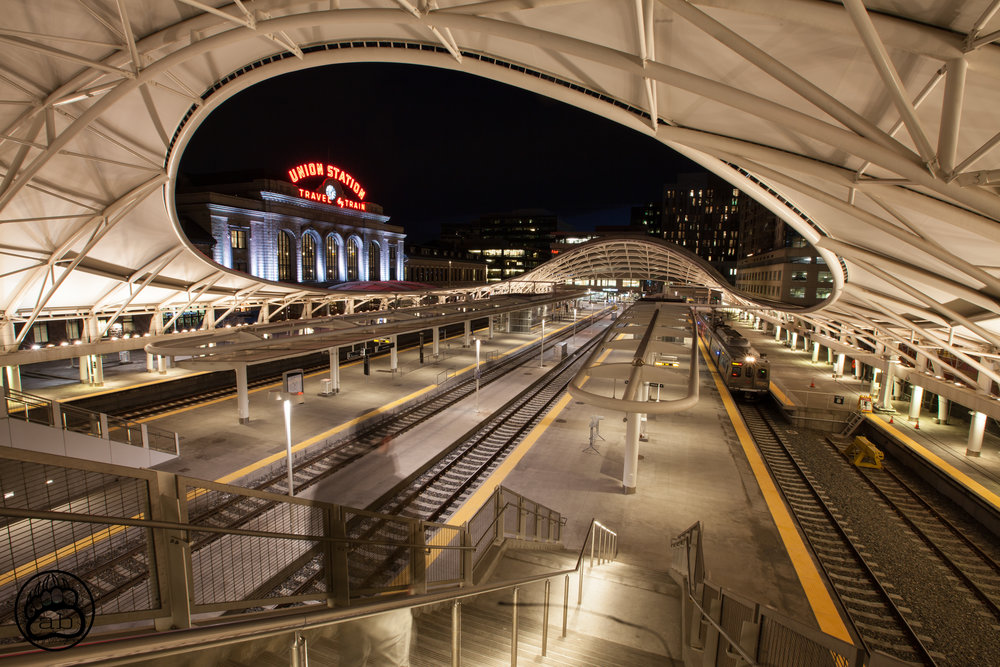 USA. Denver, Colorado. January 27, 2018. A passenger moves to board the light-rail outside of Union Station. Denver has prioritized spending on this interconnected system of light-rail trains to better connect the city and reduce its carbon footprint.
