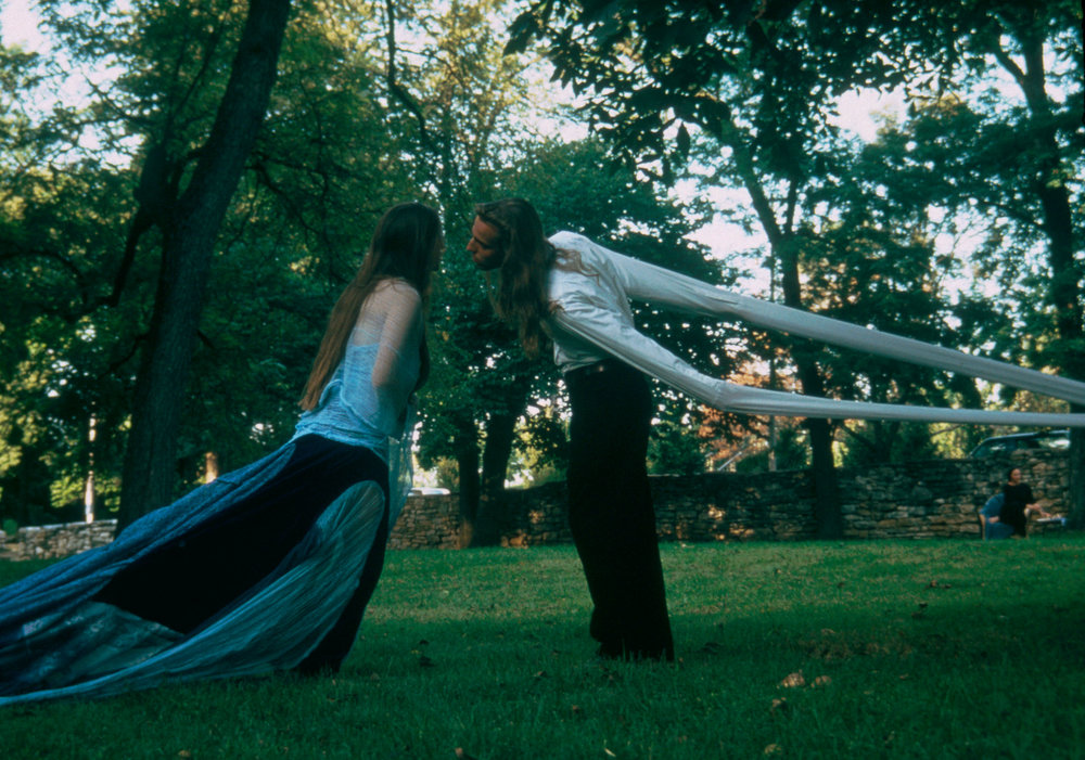 Wish   performance, Southmoreland Park, Kansas City, MO  1993  On Longing, 15' tethered dress and 15' tethered sleaves;   Wish  performance, Southmoreland Park, Kansas City, MO  1993