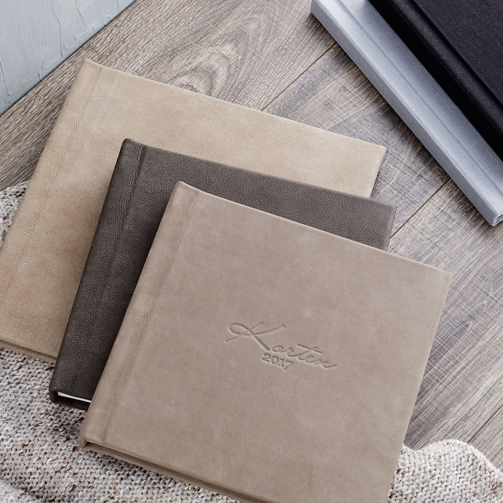 REDTREE ALBUMS & EXTRAS - 12x12 leather album: $1,50010x10 leather album: $1,2508x8 leather album: $95010x10 linen hardcover book: $75010x10 softcover book: $500bamboo presentation box: $150walnut presentation box: $300