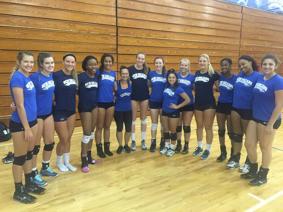 University of New Orleans volleyball team. Partner yoga and stretching.