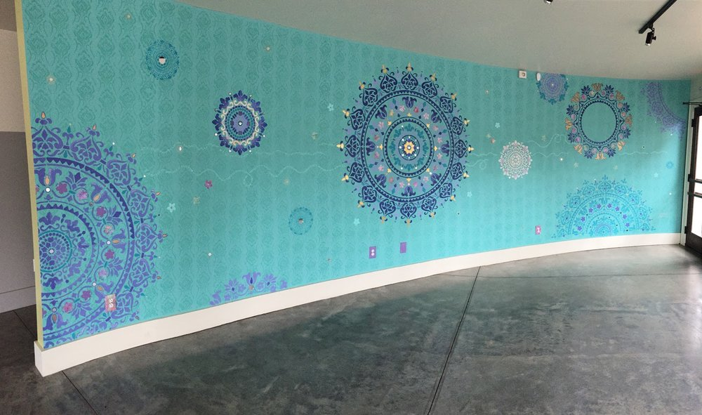 Mural of Mandalas - In this studio, we have a floating wall with a beautiful mural of mandalas created by local artist, Melissa Ligon. Mandalas are a symbol in a dream, representing the dreamer's search for completeness and self-unity. Read more about Melissa's mural.