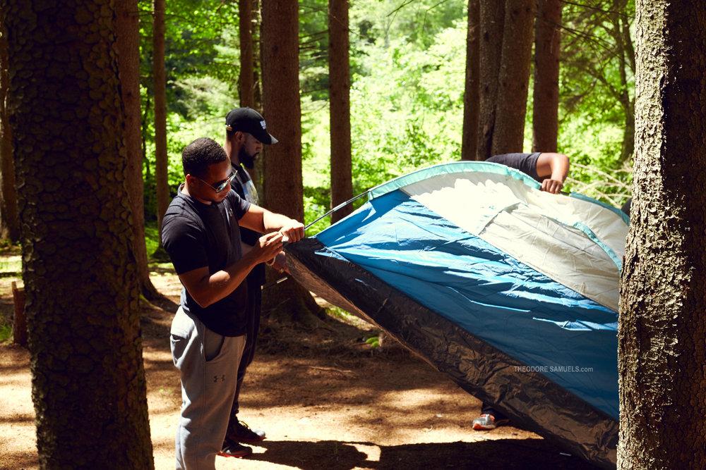 Vernon Jones, Marlon Briscoe and Frank Mena setting-up a tent
