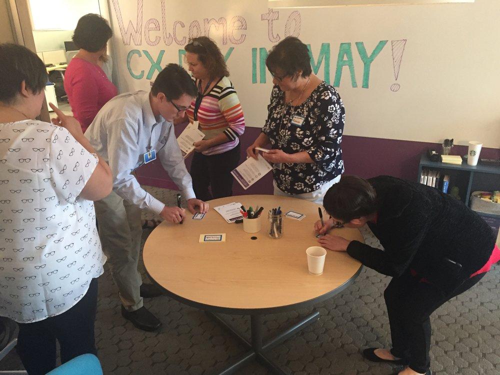"Employees creating their ""Miranda"" name tags."