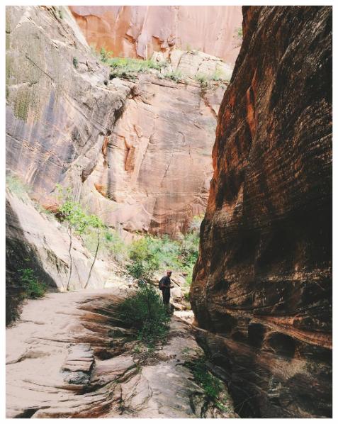 Tiny Erik next to the canyon walls.