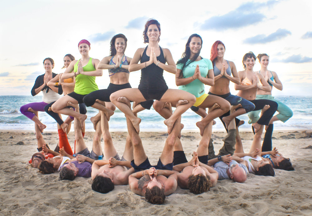Group AcroYoga in the Beach