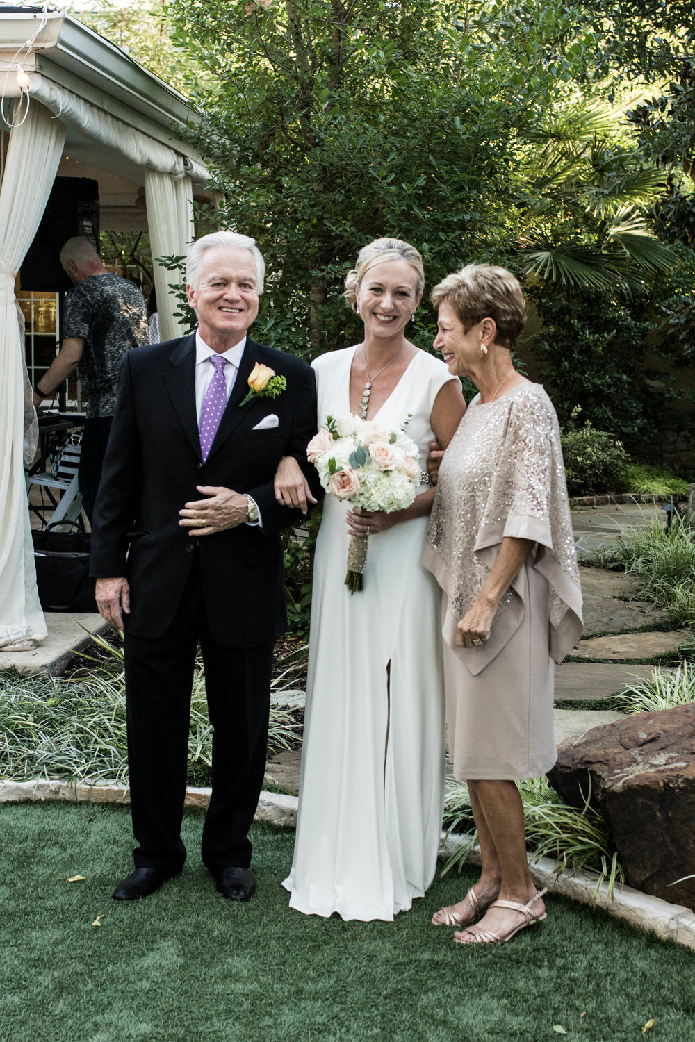 Rebecca's parents walked her down the aisle.