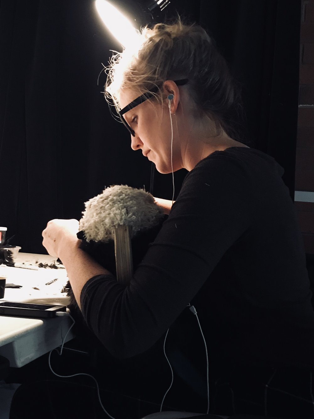 Stephanie working on Ommie the Otter puppet in rehearsal
