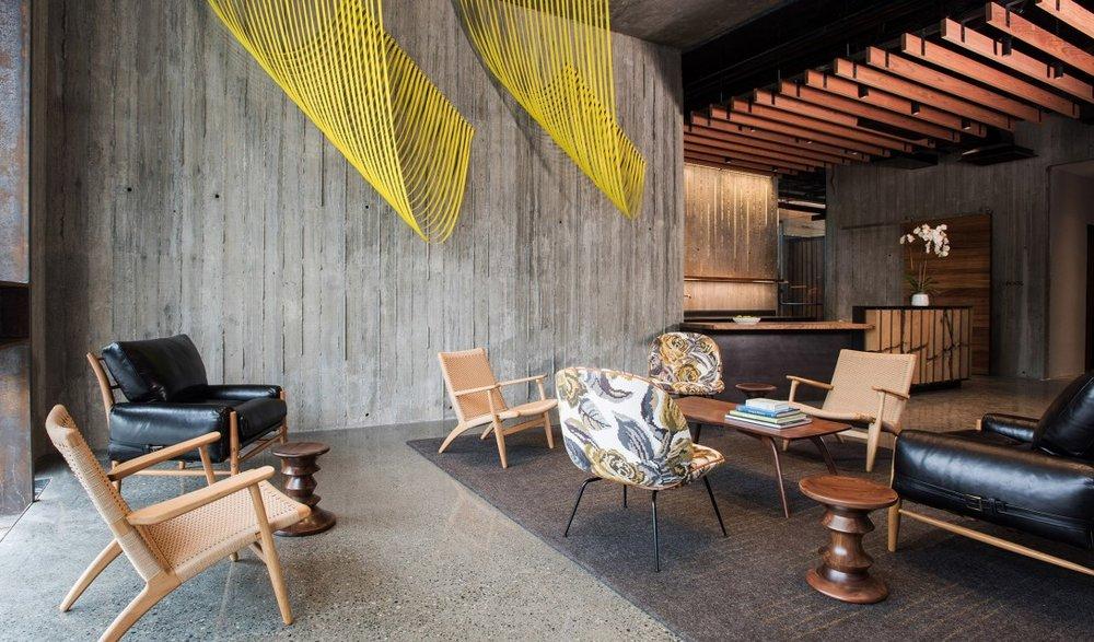 harmon-guest-house-lobby-chairs-hanging-installation-interior-design-m-02-x2.jpg