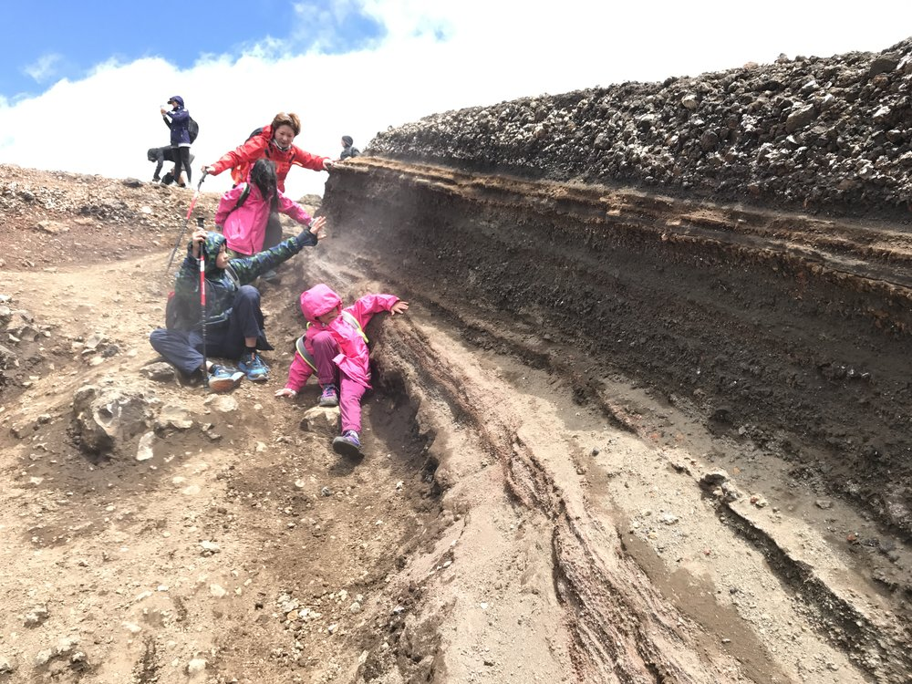 Sliding down on scree (loose stones and soil) after the Red Crater on the way to the Emerald Lakes.