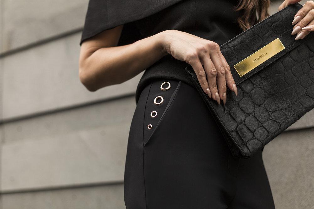 Stud pocket detailing with Balenciaga pony skin clutch.