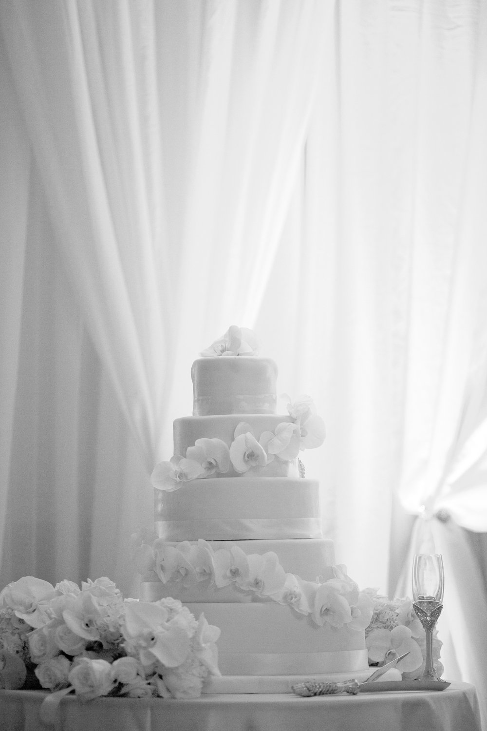 Five tier wedding cake with white flower design
