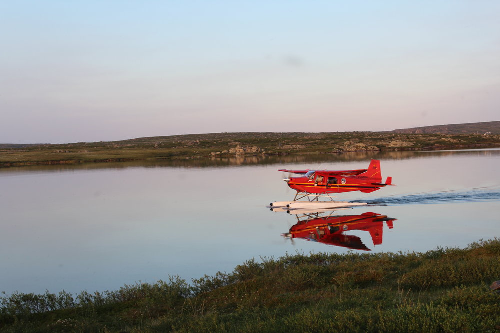 Float plane landing at Daring Lake Tundra Research Station, Northwest Territories, Canada