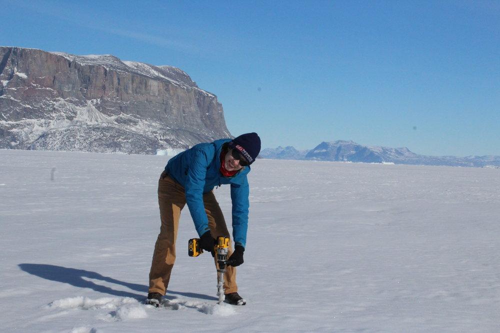 Drilling to measure sea ice thickness, Uummannaq, Greenland, April 2019