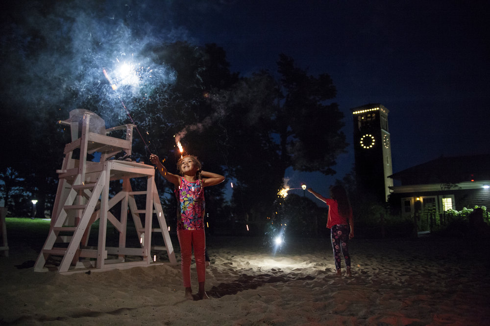 Nova Holland, left, and her sister Hana of Los Angeles, CA celebrate the fourth of July on Children's Beach at the Chautauqua Institution in Chautauqua, NY.