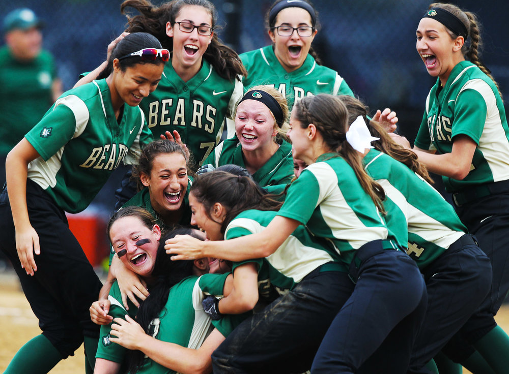 Greater New Bedford High School teammates celebrate after winning the State finals at Worcester State. Greater New Bedford played Leicester High school and won the game 5 - 1.