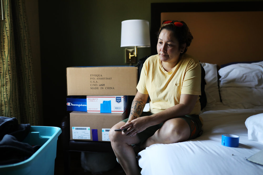 Dagmar Rivera pauses while packing up her belongings in a hotel room that she's been occupying for the past several months. The Federal Emergency Management Agency is officially ending its Temporary Sheltering Assistance Program for Puerto Rico, a program that has paid for hotel rooms for thousands of evacuees for nearly a year after Hurricane Maria devastated the island. As of now, Dagmar needs to be out of the hotel by July 15th, but has nowhere to go.