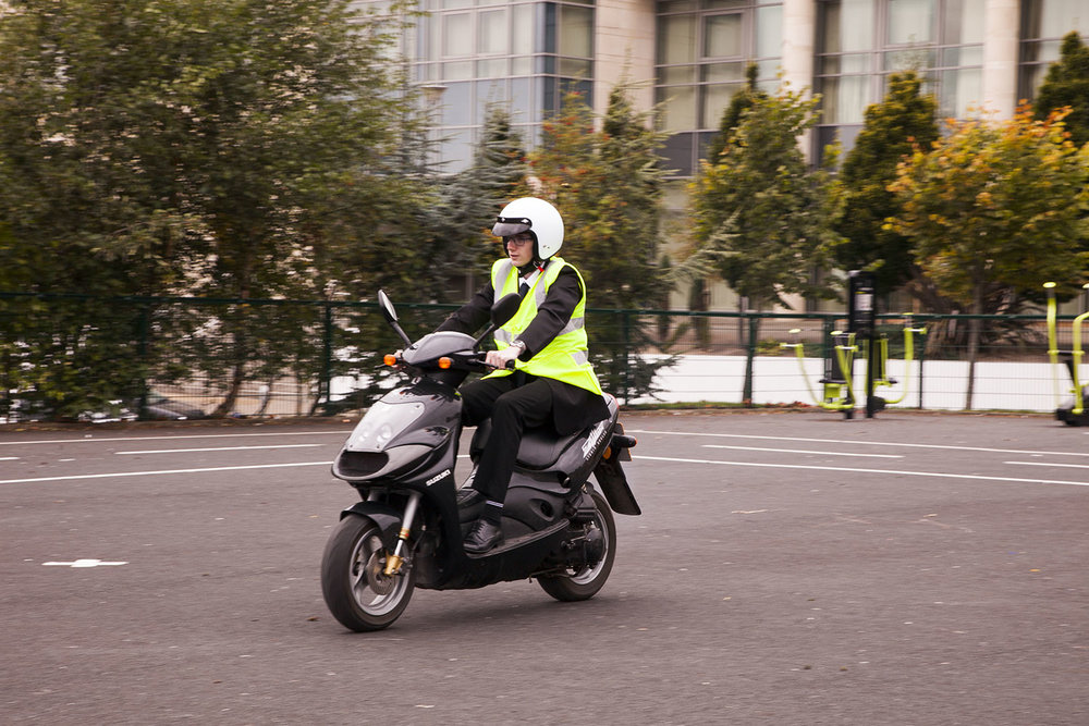 Student-riding-moped-1553.jpg