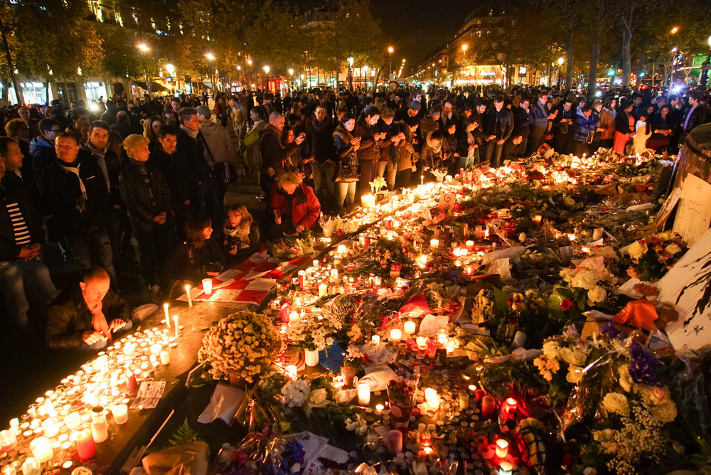 Dozens of mourning people captured during civil service in remembrance of November 2015 Paris attacks victims