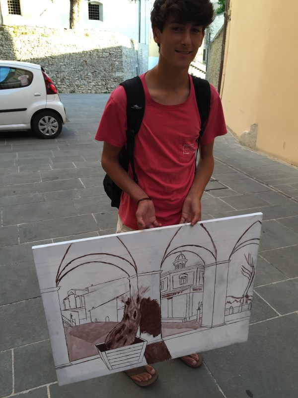 Harrison holding his start of his sinopia (underpainting) applied while observing the view from under the arches of the duomo.