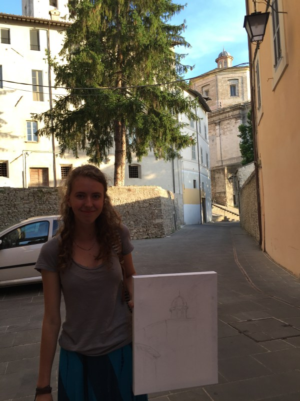 Calla holding her canvas with the beginning of her painting of the Caio Melisso.
