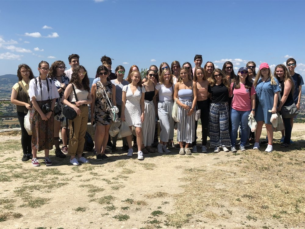 Students outside the Rocca Maggiore in Assisi, Italy.