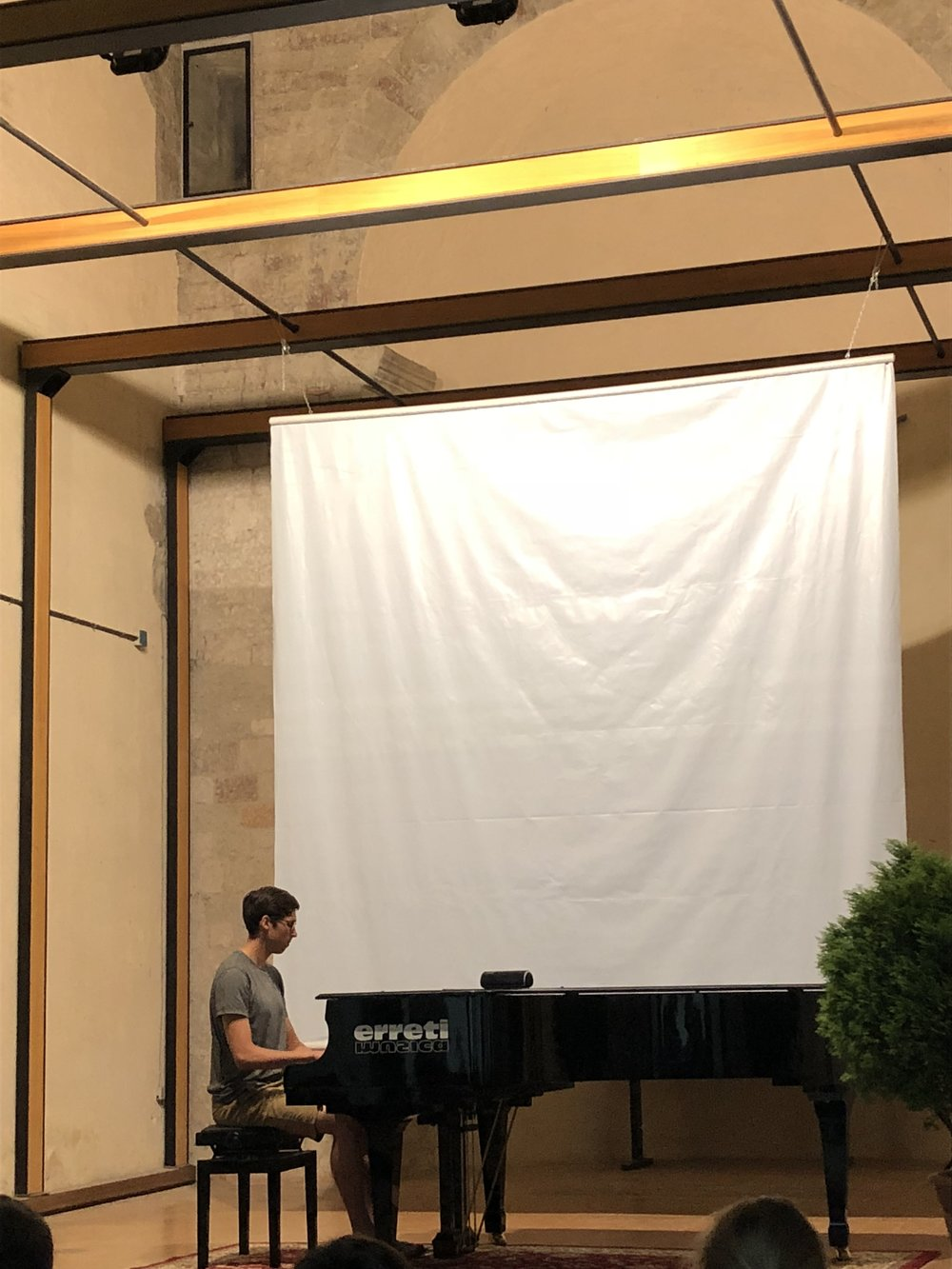 "Tom playing ""I Fall Apart"" on the piano"
