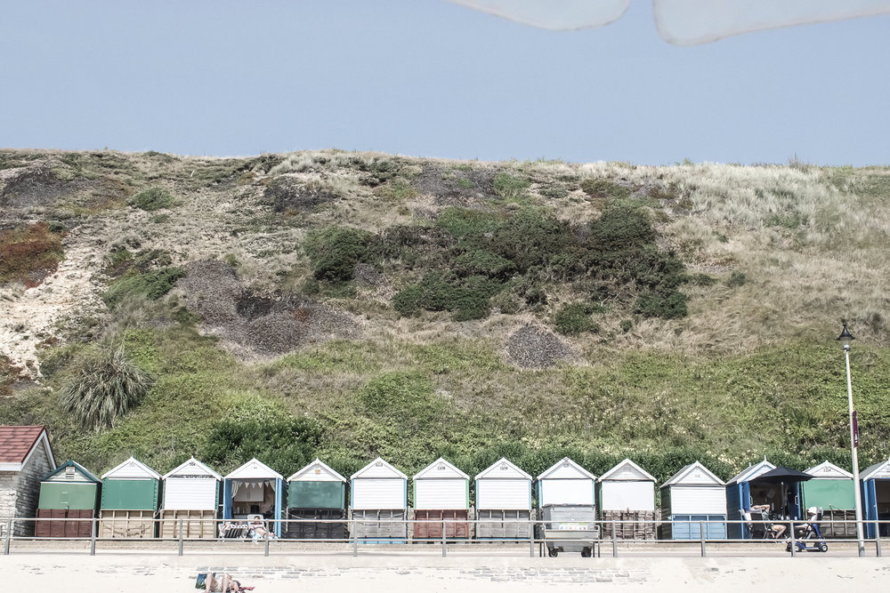 beach-huts-mountain--sand-beach.jpg
