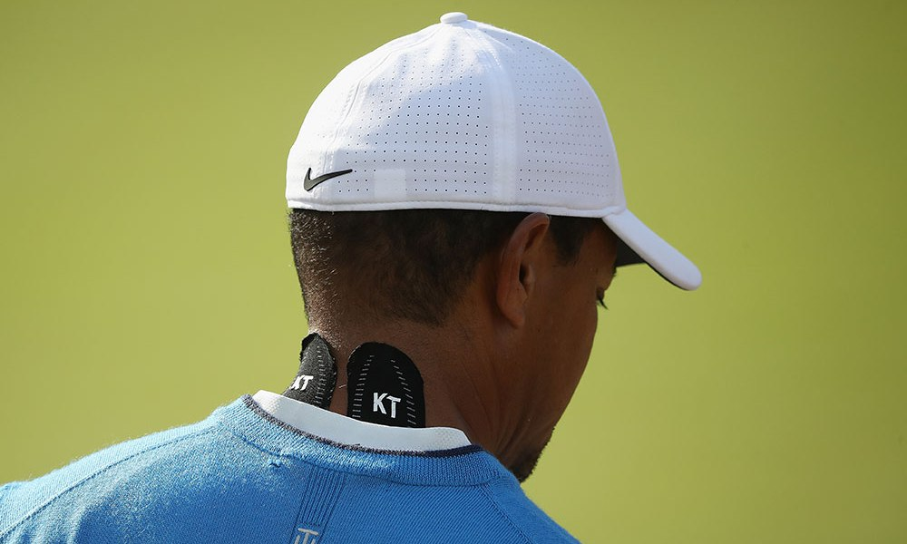 https://ftw.usatoday.com/2018/07/tiger-woods-kt-tape-neck-stiffness-reaction