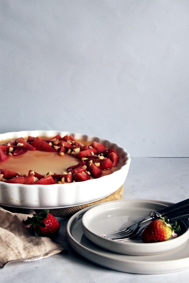 greek yogurt panna cotta pie with poached strawberries