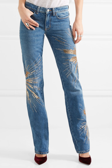 Eva embellishes low-rise slim-leg jeans