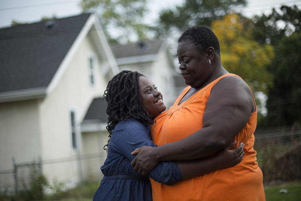 Ticiea Fletcher stands in her backyard with her daughter, Logan Jessica, 10. They live in the Jordan neighborhood of North Minneapolis.