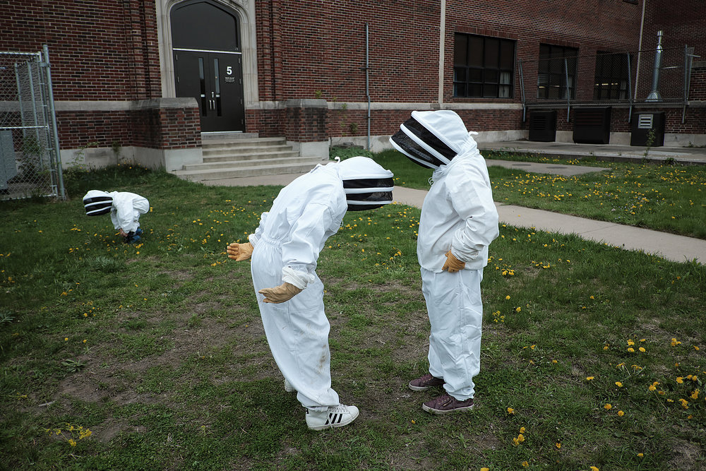 Two Loring Elementary third-graders look like moon visitors as they prepare to enter a honey bee colony as part of beekeeping lesson organized by Pollinate Minnesota in May.