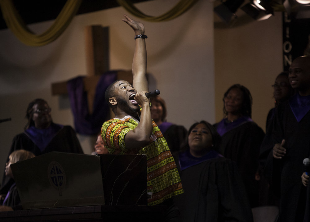 Shiloh Temple choir director Jovonta Patton, a Billboard Chart-topping gospel artist, sings and leads the choir during a Sunday service in February.