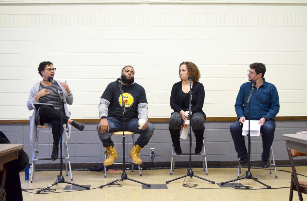Tom Weber (right), host of MPR News with Tom Weber, discusses hope in the black community with, from left, Lissa Jones, Terrall Lewis, and April Graves.  Photo by Kenzie O'Keefe