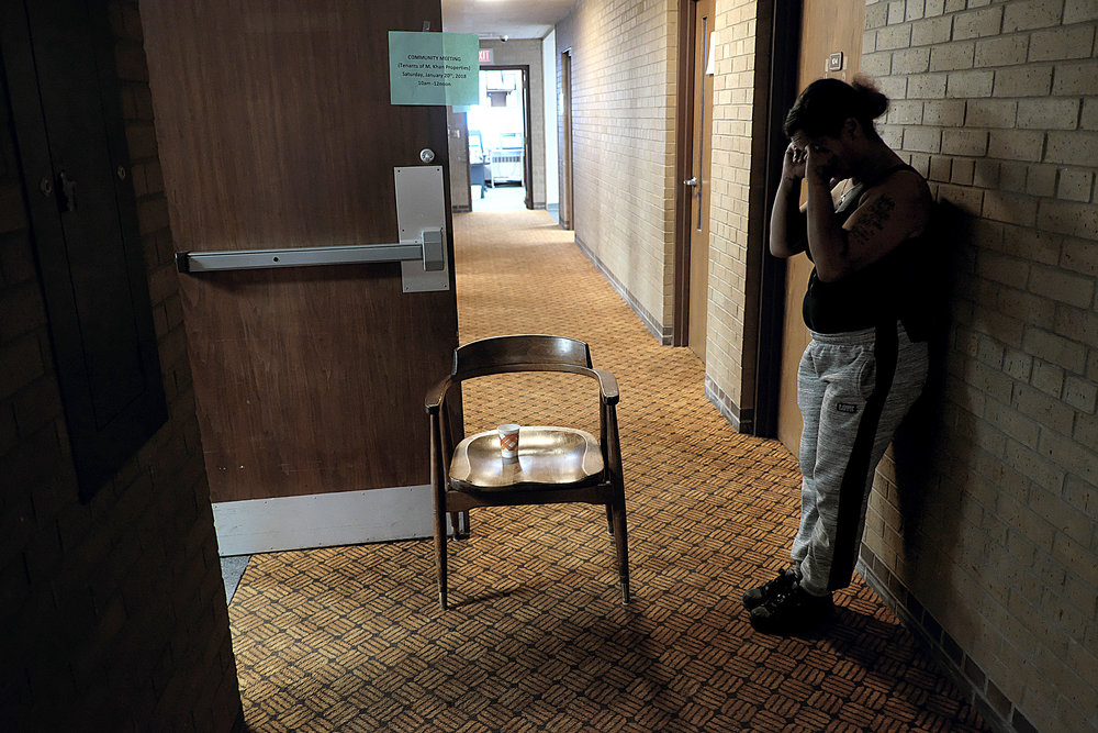 "TeCara Ayler takes a quiet moment to collect herself after becoming overwhelmed with emotion at a resource meeting for Khan tenants in mid-January. ""Day to day it's stressful. You don't know what's going to happen,"" she said.  Photo by David Pierini"