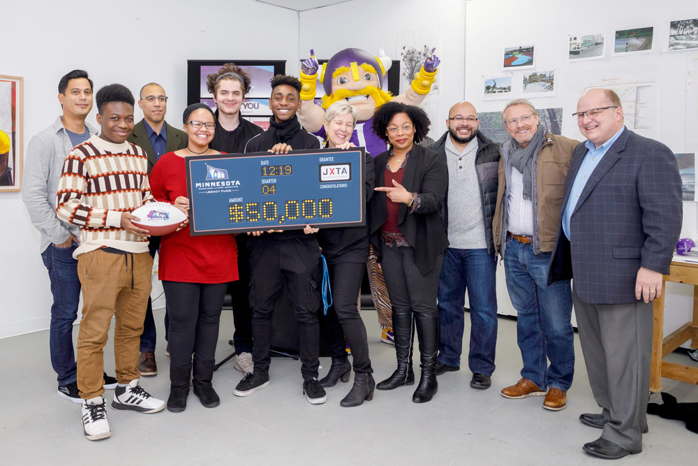 Juxtaposition Arts receives their $50K grant from the Minnesota Super Bowl Host Committee Legacy Fund. Photo courtesy of Steffenhagen Photography
