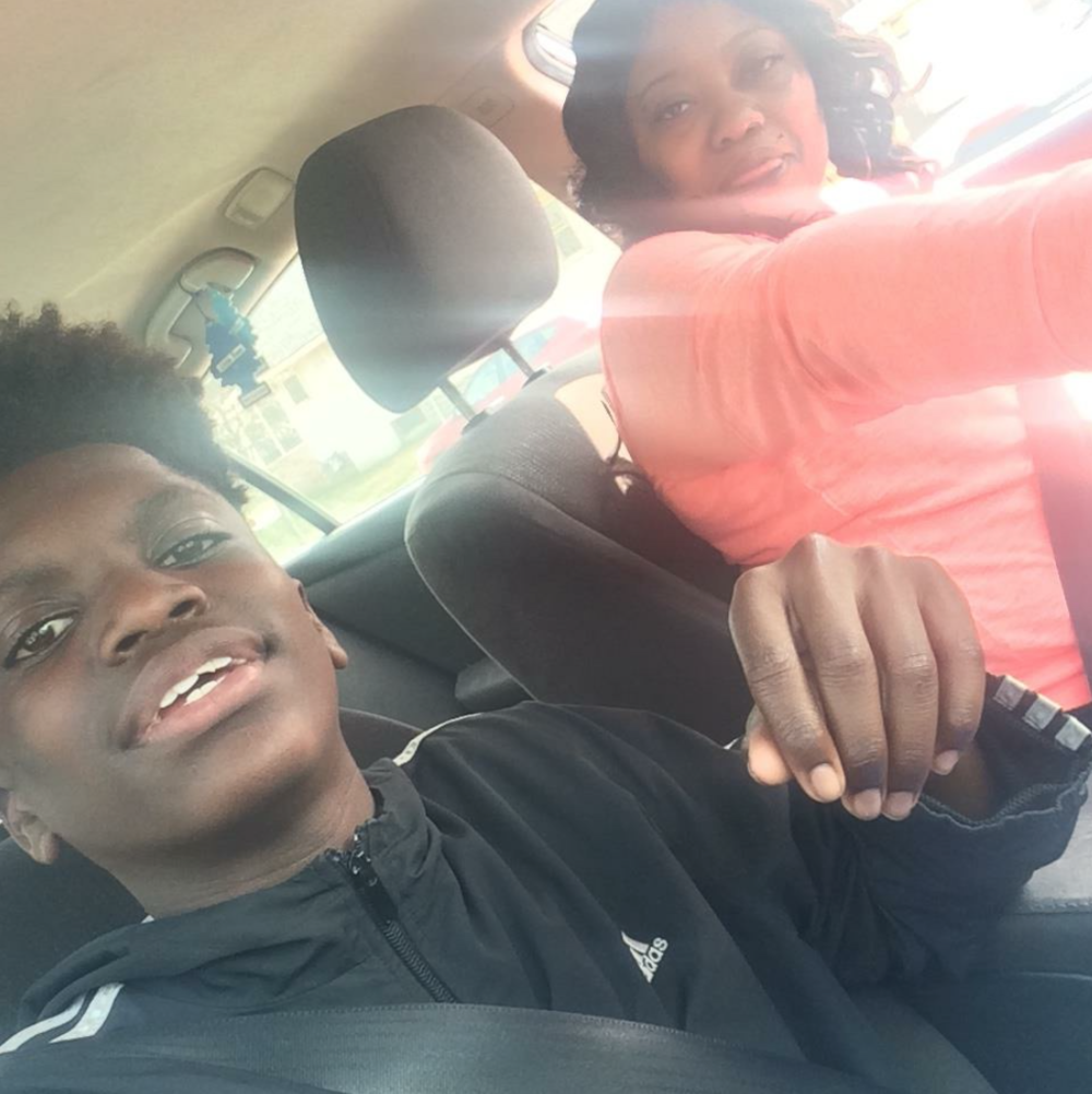 This is me and my mom on our way to the store before going to basketball practice in May. I took this picture because I want to have it for memories if anything happens to her, or she can use it if anything happens to me. My mom and I have a good relationship with each other. My mom support me in basketball because she know how you gotta work for what you want. Nothing is going to be handed to you, so she supports me by making sure I'm working on my game - both on the court and in school. She wants me to become something in life. She wants me to become what my dream is - to become an NBA player.