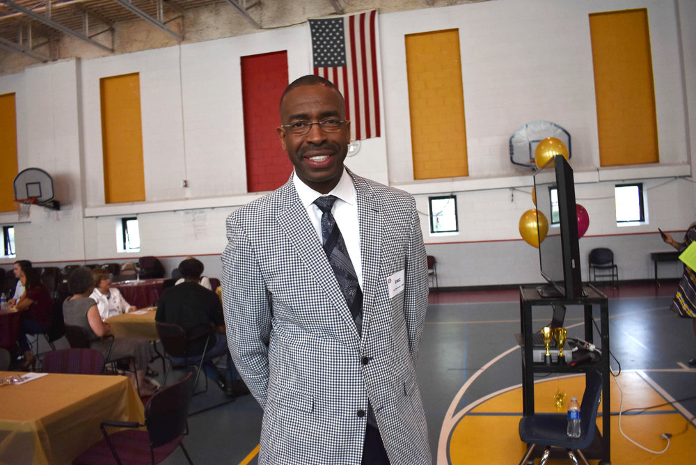 Eric Mahmoud, founder and CEO of the Harvest Network of Schools (HNS)spoke at a 2018 breakfast for HNS volunteers and community partners where they announced the future of HNS and its schools. Photo by Cirien Saadeh