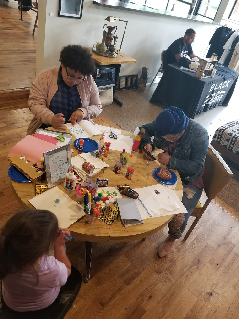 Angelina and Aliya Tchougo participated in the crafts offered at 'Dads, Dreams, and Donuts.'  Photo by Markella Smith