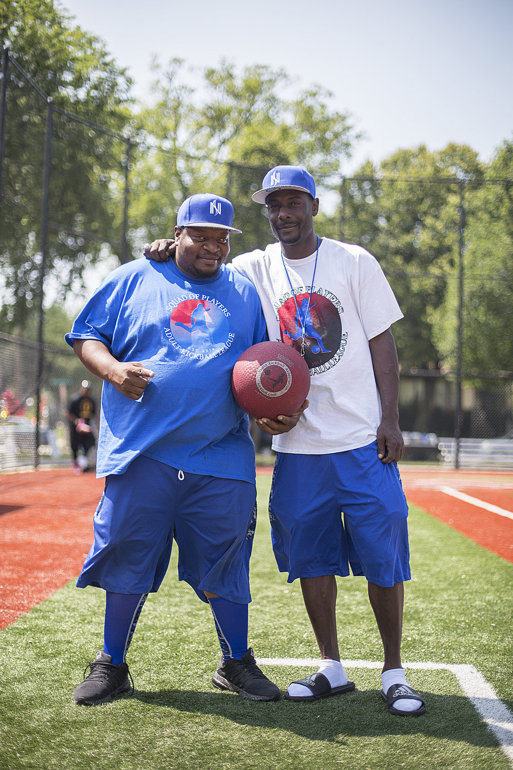 Educators Londell Anderson (left) and Tyrone Johnson have brought hundreds to North Commons Park each summer Sunday for the Squad of Players Adult Kickball League.  Photo by David Pierini