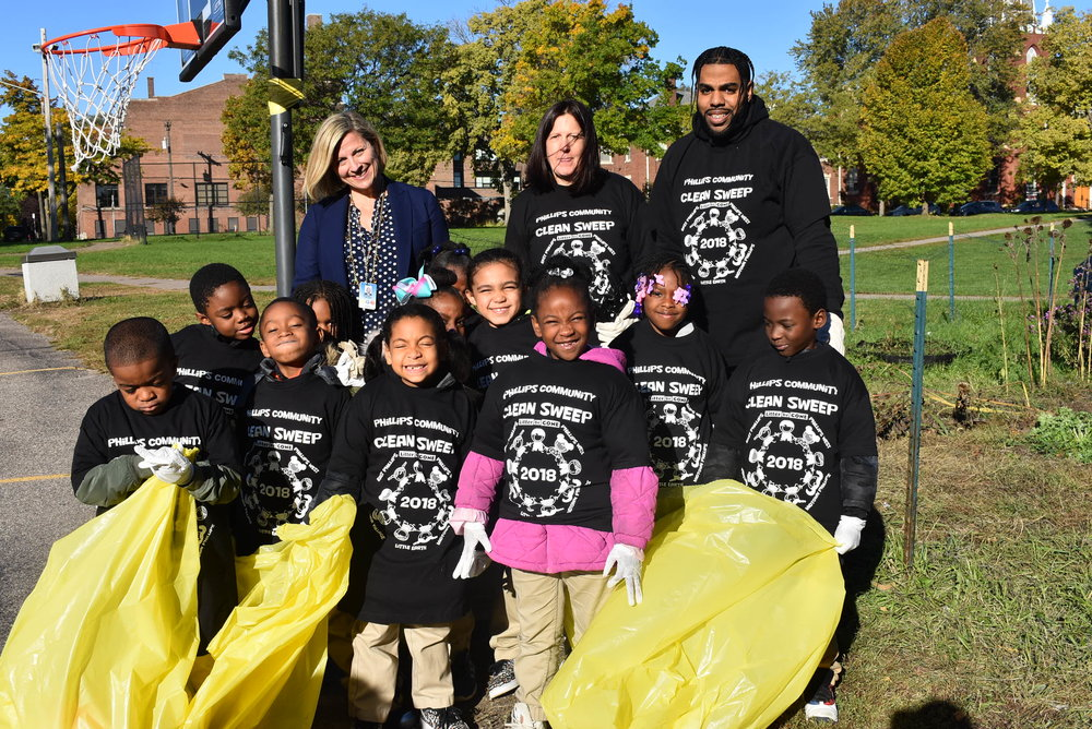 Principal Lindsey joined students and educators from Mrs. Patty Phillips' first grade classroom as they cleaned up the school's playground.  Photos by Cirien Saadeh