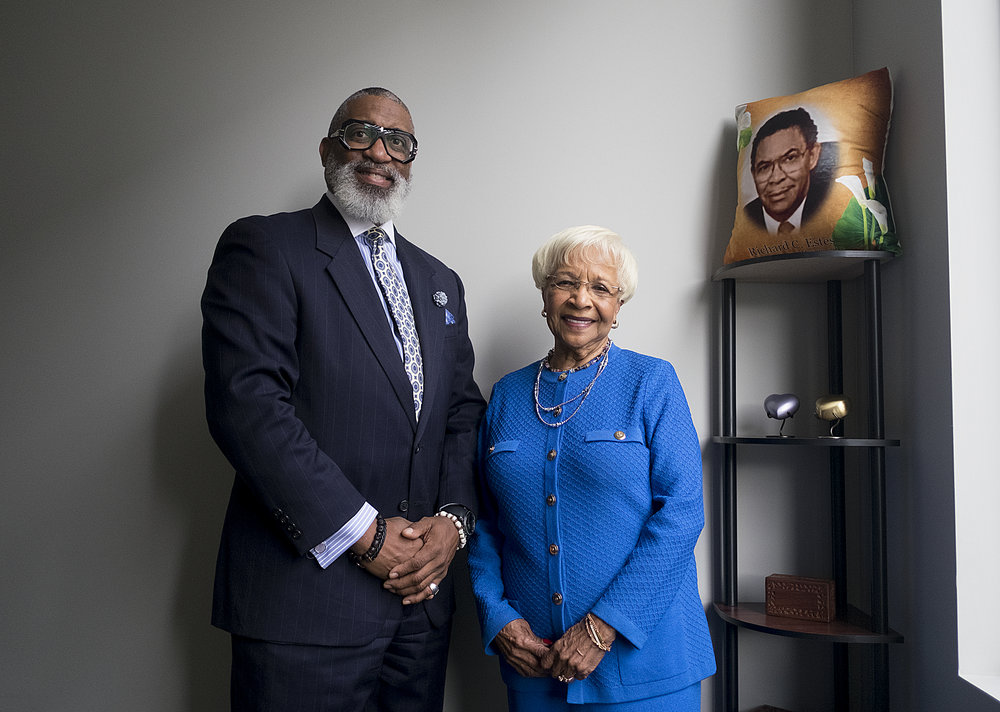 Funeral director Tracy Wesley and his aunt, April Estes, stand inside the new Estes Funeral Home, its third chapel since being founded in 1962 by Richard Estes, April's late husband whose face adorns the pillow.