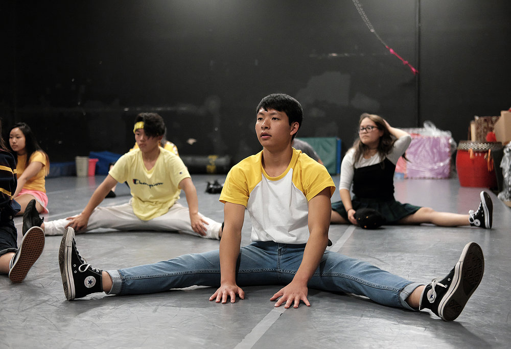 Asian Media Access, a youth program that uses technology, art, and community organizing to improve cultural understanding and develop leadership skills, is located on Plymouth Ave. Here, Keng Thao, center, stretches with friends in the dance studio at AMA before practicing hip-hop dance moves for an upcoming performance this past summer.