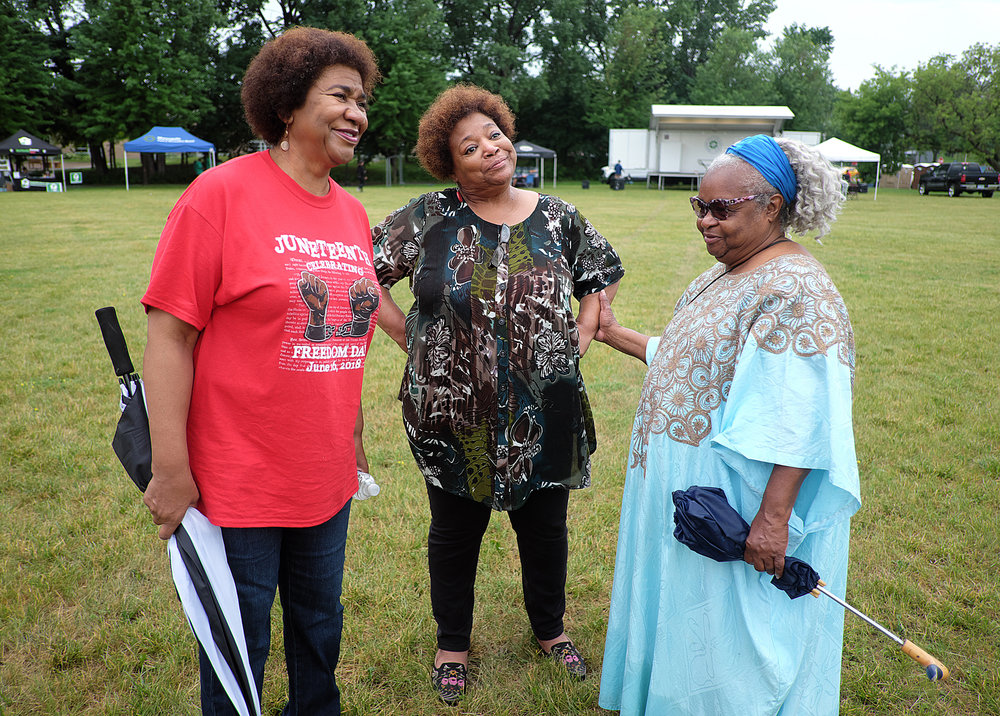 "Freedom Day, a celebration of Juneteenth, was held in Bethune Park this year. Park Board Superintendent Mary Merrill (left) was instrumental in making it happen. Renowned storyteller Nothando Zulu (right) performed a piece called ""Libations"" on stage at the event."